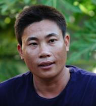 Fisherman Tran Hien talks during an interview with AFP in Ly Son Island off the central province of Quang Ngai in August 2012. When gun-toting Chinese guards spotted Tran Hien's unarmed wooden fishing boat in disputed waters, they seized his vessel, detained his crew and threw him in jail