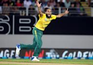 South Africa's Imran Tahir celebrates taking the wicket of New Zealand's Luke Ronchi during the Twenty20 international at Eden Park in Auckland on February 17, 2017