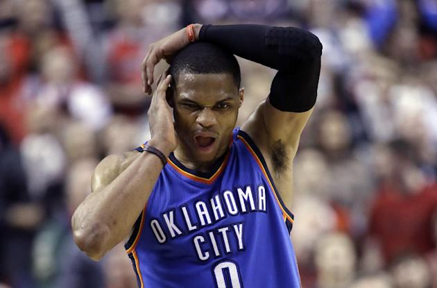 Oklahoma City Thunder guard Russell Westbrook walks down court with only seconds to go during the second half of an NBA basketball game against the Portland Trail Blazers in Portland, Ore., Friday, Fe