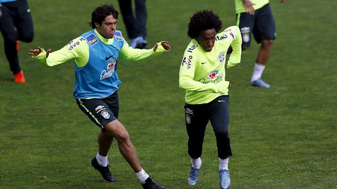 Brazil's players Kaka and Willian attend a team training session in Santiago