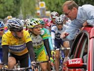 Christian Prudhomme (R), seen here talking to Lance Armstrong during the 92nd Tour de France, in 2005. Tour de France director Prudhomme said he was against re-attributing disgraced Armstrong's seven victories in the world's most prestigious cycling race
