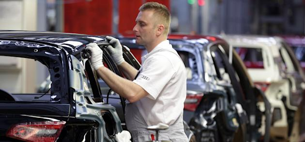 FILE - In this March 11, 2013 file photo, an employee of Audi works in the assembly line of the Audi production site in Ingolstadt, southern Germany.  Mexico is attracting luxury automakers such as Au