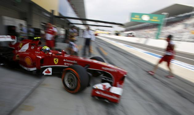 Ferrari Formula One driver Massa of Brazil drives out of his garage during the third practice session of the Japanese F1 Grand Prix at the Suzuka circuit