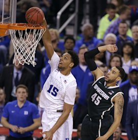 Duke's Jahlil Okafor (15) dunks the ball ahead of Michigan State's Denzel Valentine during the second half. (AP)