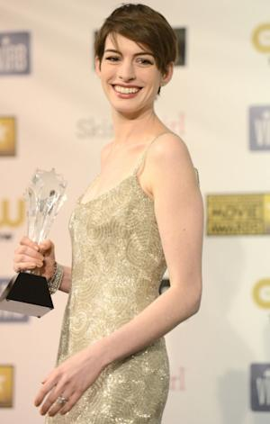 Anne Hathaway, winner of Best Supporting Actress for 'Les Miserables,' poses in the press room at the 18th Annual Critics' Choice Movie Awards held at Barker Hangar on January 10, 2013 in Santa Monica, Calif. -- Getty Images