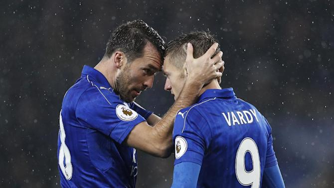 Leicester City's Jamie Vardy celebrates scoring their first goal with Christian Fuchs