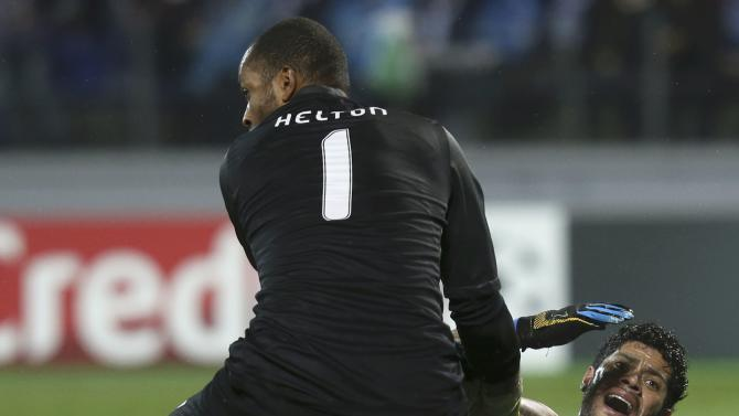Zenit St Petersburg's Hulk reacts as Porto's goalkeeper Helton helps him to stand up during their Champions League soccer match at the Petrovsky stadium in St. Petersburg