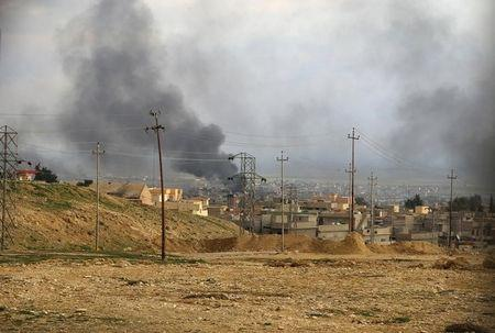 U.S.-led air strikes hit Islamic State targets in Syria and Iraq