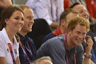 Great Britain's Prince William (second left), his wife Kate and brother Prince Harry celebrate their team's victory at the end of the gold final of the men's team sprint at the London 2012 Olympic Games on August 2. Hosts Britain will take a huge step towards restoring their track cycling supremacy if they come away with the coveted men's Olympic team pursuit gold later Friday