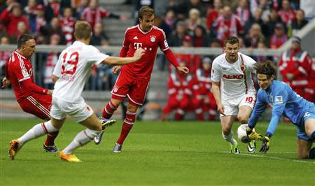 Augsburg's Manninger saves a shot from Bayern Munich's Ribery during their German first division Bundesliga soccer match in Munich