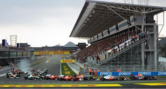 Drivers power their cars after the start of the Formula One Korean Grand Prix in Yeongam on October 16, 2011. AFP PHOTO / SAEED KHAN (Photo credit should read SAEED KHAN/AFP/Getty Images)