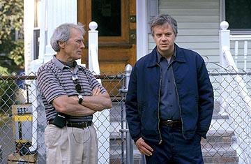 Director Clint Eastwood and Tim Robbins on the set of Warner Bros. Mystic River