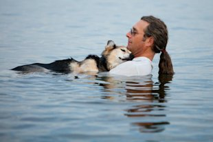 John Unger takes his dog, Schoep, into Lake Superior.