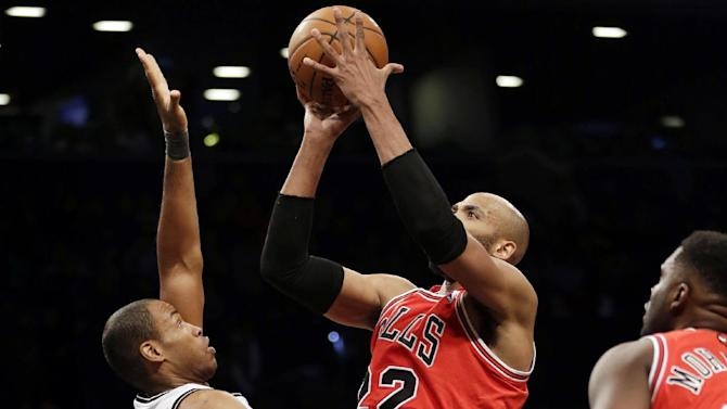 Brooklyn Nets' Jason Collins, left, defends Chicago Bulls' Taj Gibson during the second half of an NBA basketball game Monday, March 3, 2014, in New York. The Nets won 96-80. (AP Photo/Seth Wenig)