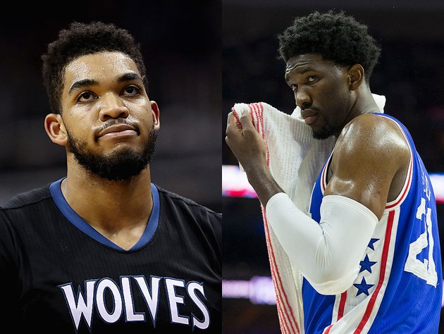 Joel Embiid and Karl-Anthony Towns are ready for their in-game, three-point shootout. (Getty Images)