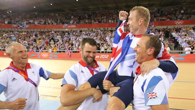 Britain's Chris Hoy is carried by officials as they celebrate after the track cycling men's keirin finals at the Velodrome during the London 2012 Olympic Games
