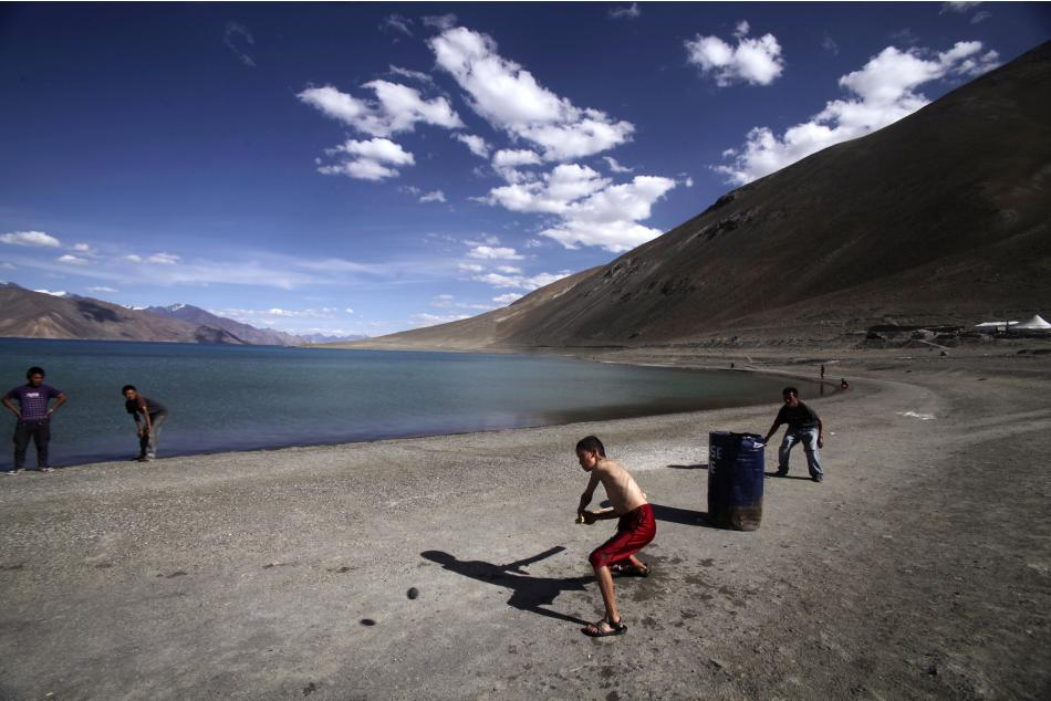 In this Friday, July 22, 2011 photo, children play cricket near Pangong Lake, near the India-China border in Ladakh, India. Ladakh is a remote part of the former princely state of Kashmir, which is at