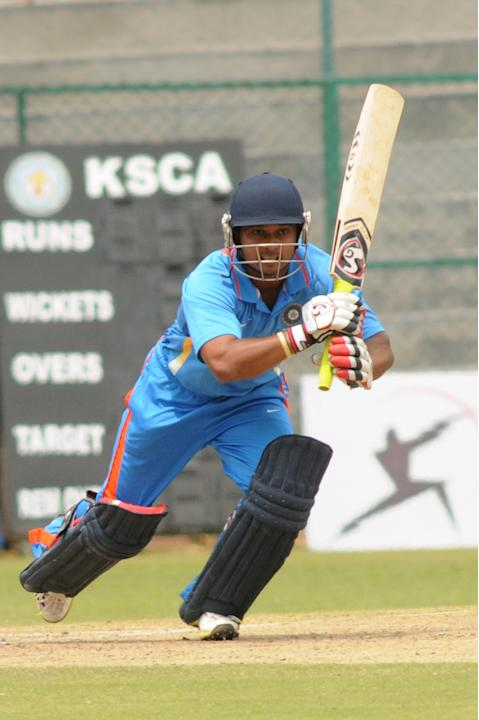 Indian A team Player KM Jadhav in action against West Indies A team, during  India A team v/s West Indies A team unofficial T-20 cricket match at Chinnaswamy Stadium, in Bangalore on Saturday 21st of