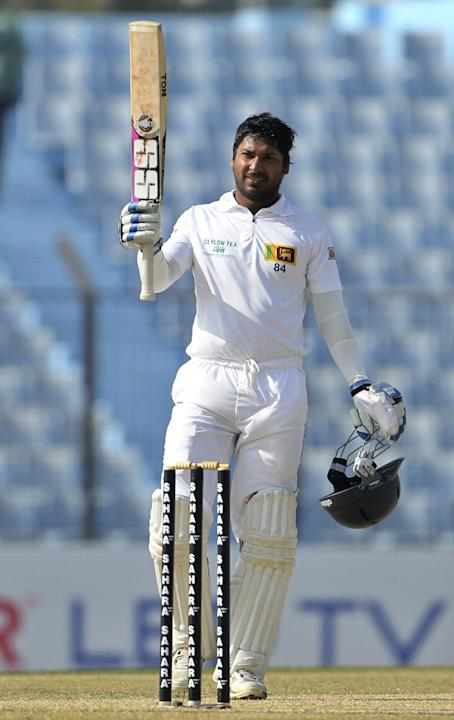 Sri Lanka's Kumar Sangakkara acknowledges the crowd after scoring a century on the first day of the second test cricket match against Bangladesh in Chittagong, Bangladesh, Tuesday, Feb. 4, 2014. Sanga