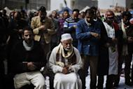 Egyptian anti-government protestors perform Friday prayers ahead of a demonstration against Egypt's President in Cairo's landmark Tahrir square on February 22, 2013. Anger in the country has been fuelled not just by political divisons but by a crippling economic crisis.