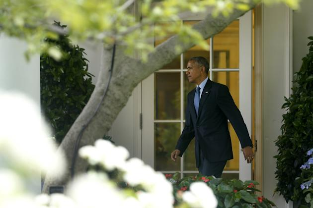 Obama departs the Oval Office for travel to Miami from the South Lawn of the White House in Washington