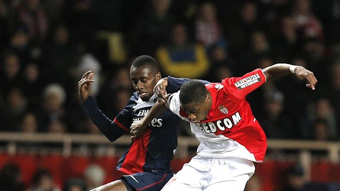 Paris Saint Germain's Blaise Matuidi of France, left challenges for the ball with Monaco's Geoffrey Kondogbia  of France during their French League One soccer match, in Monaco stadium, Sunday, Feb. 9 , 2014