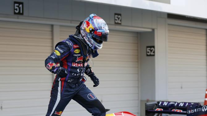 Red Bull Formula One driver Vettel of Germany celebrates after winning the Japanese F1 Grand Prix at the Suzuka circuit