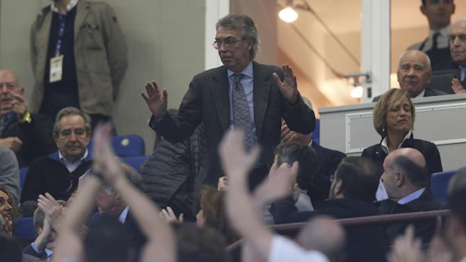 Inter Milan President Massimo Moratti arrives prior to the start of the Serie A soccer match between Inter Milan and Hellas Verona at the San Siro stadium in Milan, Italy, Saturday, Oct. 26, 2013