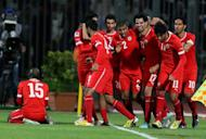 Bahraini players celebrate after scoring against Iraq during their Gulf Cup match in Manama, January 15, 2013. In the match to decide third place, hosts Bahrain take on 10-time champions Kuwait