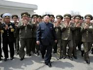 This file photo, released by North Korea's official Korean Central News Agency (KCNA) on April 28, shows N.Korean leader Kim Jong-Un (C) surrounded by officers of Korean People's Army (KPA) during the general tactical exercise of an army unit