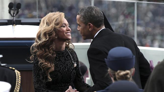 President Barack Obama greets singer Beyonce on the West Front of the Capitol in Washington, Monday, Jan. 21,2013, after she sang the national anthem at the ceremonial swearing-in ceremony during the 57th Presidential Inauguration. (AP Photo/Win McNamee, Pool)