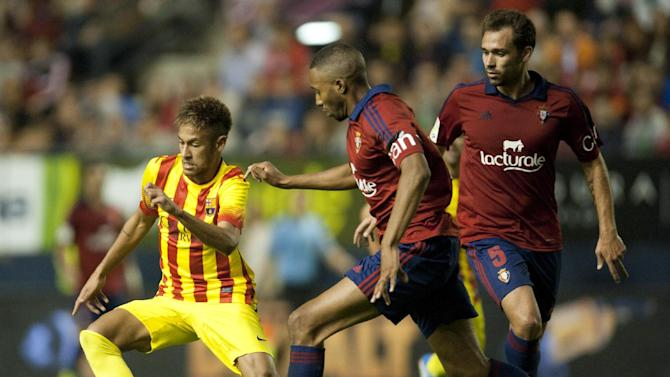 FC Barcelona's Neymar , of Brazil, left, duels for the ball with  Osasuna's Jordan Loties of France, center, and Lolo, during their Spanish League soccer match, at El Sadar stadium, in Pamplona northern Spain on Saturday, Oct. 19, 2013