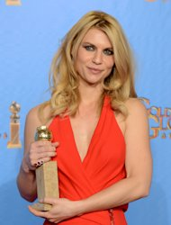 "Actress Claire Danes poses with the award for best performance by an actress in a television series - drama for ""Homeland"" backstage at the 70th Annual Golden Globe Awards at the Beverly Hilton Hotel on Sunday Jan. 13, 2013, in Beverly Hills, Calif. (Photo by Jordan Strauss/Invision/AP)"