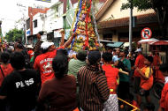Jostling crowd: The mountain of market fruits was one of the main attractions for the crowd watching the parade. (