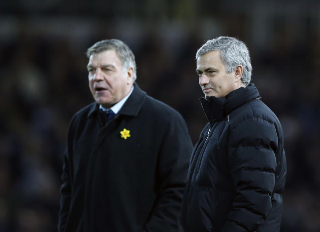 Chelsea's head coach Jose Mourinho, right, speaks to West Ham United's manager Sam Allardyce during the English Premier League soccer match between West Ham United and Chelsea , at the Boleyn grou