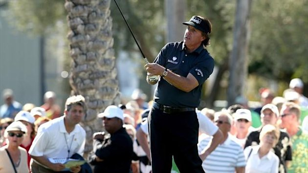 Phil Mickelson watches his tee shot on the 10th hole during the first round of the Humana Challenge (AFP)