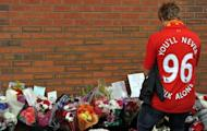 A fan pays his respects outside Anfield on September 23, 2012 to the 96 supporters who died in the Hillsborough disaster. Britain announced a new police investigation into the 1989 Hillsborough football disaster in which 96 Liverpool fans were crushed to death