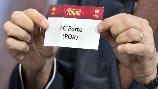 Former italian soccer player  Ciro Ferrara shows a ticket with Portugal's soccer team FC Porto during the draw of the quarterfinals of UEFA Europa League 2013/14 at the UEFA Headquarters in Nyon, Switzerland, Friday, March 21, 2014