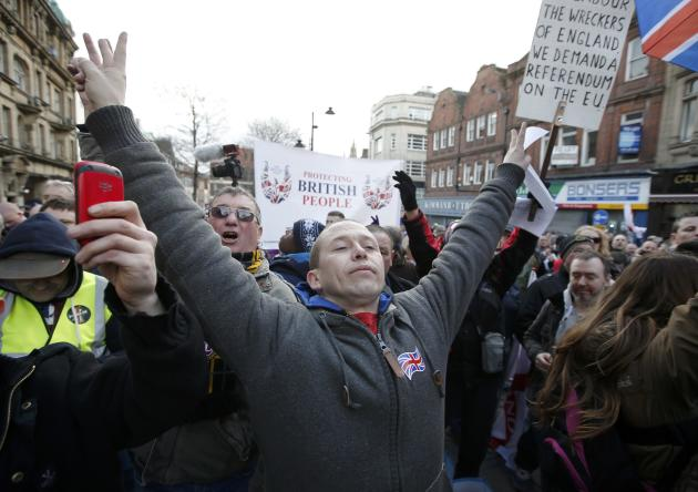 A man gestures during a demonstration by supporters of the Pegida movement in Newcastle, northern England