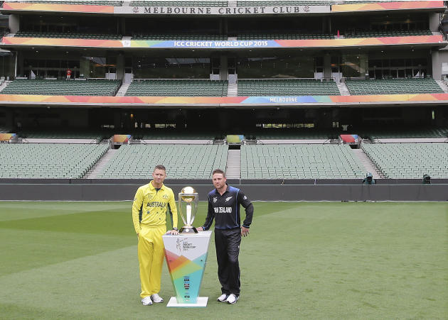 Australia's captain Michael Clarke, left, and New Zealand's captain Brendon McCullum pose for a photo with the Cricket World Cup trophy at the MCG in Melbourne, Australia, Saturday, March 28, 2015