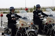 Jordanian policewomen ride motorcycles at al-Muwaqar academy. A final decision is expected in July on whether women footballers should be allowed to wear hijabs