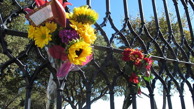 Southfork Ranch can be seen through a gate where fans left flowers Saturday, Nov. 24, 2012, in Parker, Texas. The flowers were in memory of Larry Hagman, who played J.R. Ewing on the TV series Dallas, set at Southfork. Hagman died Friday, Nov. 23, 2012 in Dallas. He was 81. (AP Photo/Angela K. Brown)