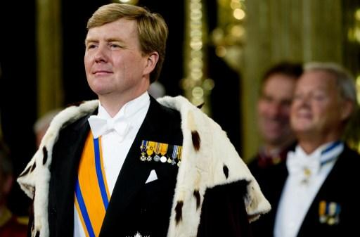 King Willem-Alexander of the Netherlands attends his investiture at the Nieuwe Kerk (New Church) in Amsterdam, on April 30, 2013.  AFP PHOTO / POOL / ROBIN UTRECHT