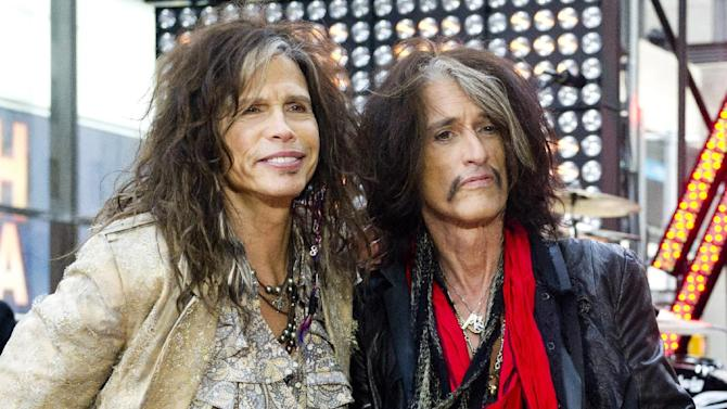 """FILE - This Nov. 2, 2012 file photo shows Steven Tyler, left, and Joe Perry of Aerosmith on NBC's """"Today"""" show in New York. Perry and Tyler of Aerosmith and Mick Jones and Lou Gramm of Foreigner will join the Songwriters Hall of Fame  this year along with the writers of iconic rock hits """"Love Is a Battlefield"""" and """"Heartache Tonight"""" during a June 13 ceremony in New York.(Photo by Charles Sykes/Invision/AP, file)"""