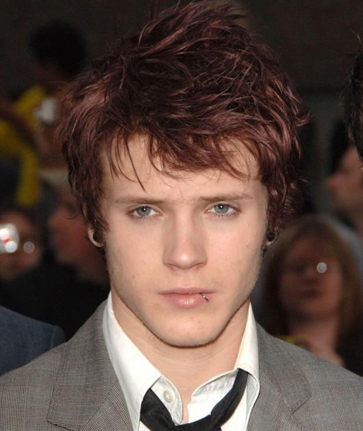 Dougie Poynter photos: The Emo look complete with red hair and lip ring wasn't our favourite.