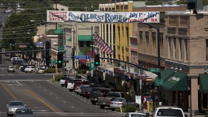 Traffic makes its way through downtown Prescott, Ariz., Wednesday, July 3, 2013, in Prescott, Ariz., After 19 Granite Mountain Hotshot firefighters died when an out-of-control blaze overtook them near Yarnell, Ariz. on Sunday life goes on in Prescott, but so too does the mourning for their lost heroes, some of them native sons. (AP Photo/Julie Jacobson)