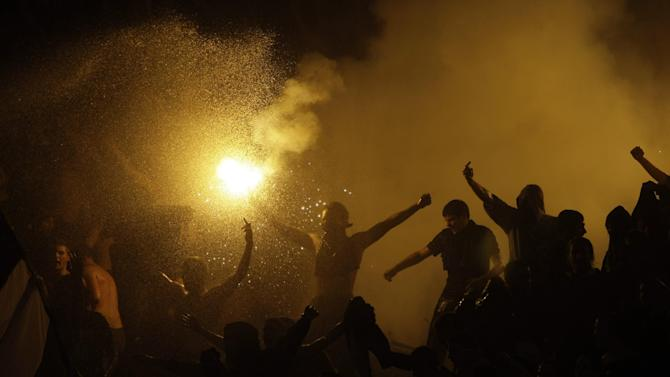 Partizan Belgrade fans ignite flares during their team's Serbian league soccer game against arch rivals Red Star in Belgrade, Serbia, Saturday, Nov. 2, 2013. Violence on the stands during soccer matches is becoming a regular occurrence in Serbian league soccer