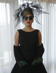 "FILE - In this Feb. 29, 2012 file photo, performer Lady Gaga poses for a portrait in her hotel suite prior to an event launching her ""Born this Way"" foundation at Harvard University in Cambridge, Mass. Lady Gaga has said she's performed electronic music for years and struggled early in her career because the sound wasn't popular. She had her breakthrough in 2008 with various electronic-tinged hits, from ""Poker Face"" to ""Just Dance."" (AP Photo/Charles Krupa, file)"
