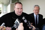 "Megaupload boss Kim Dotcom leaves court after he was granted bail in Auckland in February 2012. New Zealand Prime Minister John Key has apologised to Kim Dotcom over an ""unacceptable"" bungle by government spies leading up to his arrest"