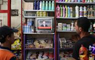 Syrians listen to the televised speech of Syrian President Bashar al-Assad at a store in Damascus. Assad on Sunday dismissed allegations that his government had a hand in the Houla massacre and accused foreign-backed forces of plotting to destroy Syria